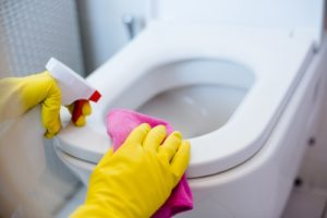 What causes black spots in toilet bowl